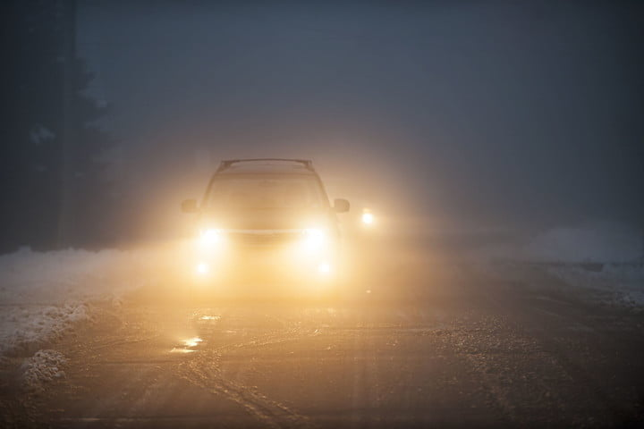 winter driving tips 19014564 bright headlights of a car on foggy road 2 720x720