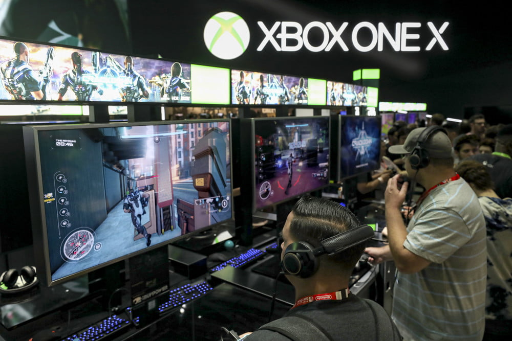 Mike Ybarra interview — Gamers test 'Crackdown' on the XBox One X during the Electronic Entertainment Expo E3 at the Los Angeles Convention Center on June 13, 2017 in Los Angeles, California.