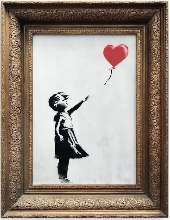 banksy artwork self destructs after it auctions for 13 million girl with balloon
