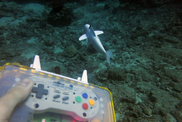 mit soft robotic fish 2sofi swimming with close up of remote control