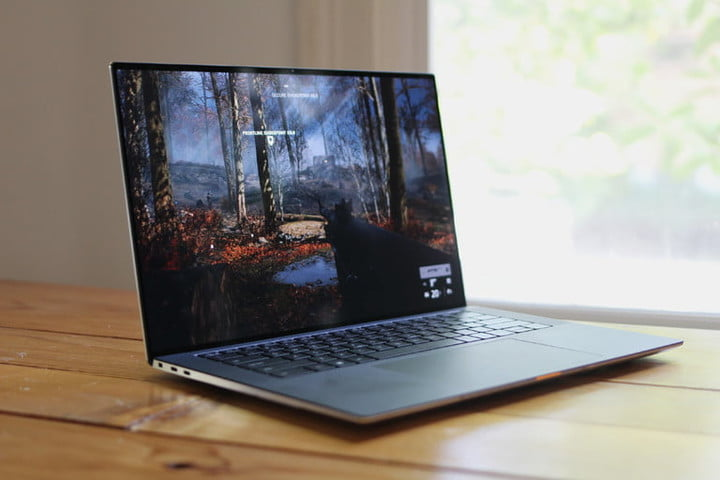 Dell XPS 15 with a forest screen to compare Dell vs.  HP