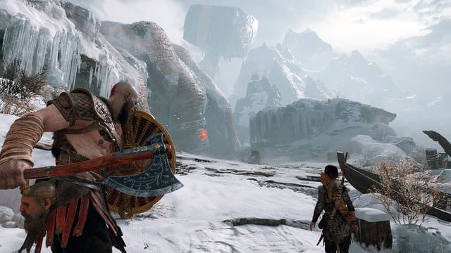 God of War Review | Kratos and Atreus draw their guard as they see an enemy in the distance