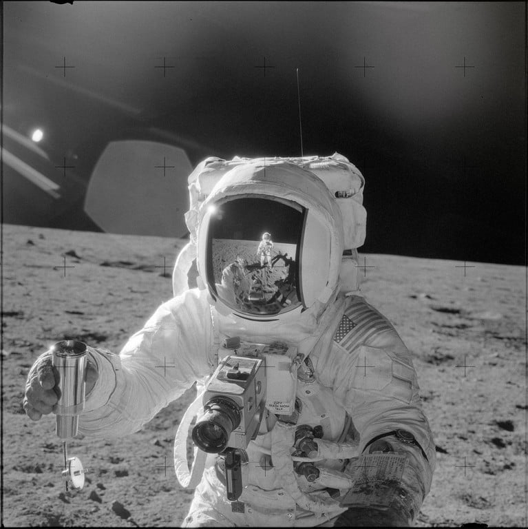 Astronaut Alan L. Bean on the moon while holding the Hasselblad 500EL Data Camera