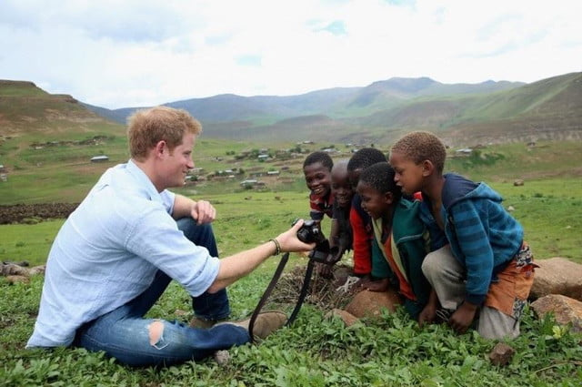 may never king prince harry career photography hrh henry sentebale showing camera to kids