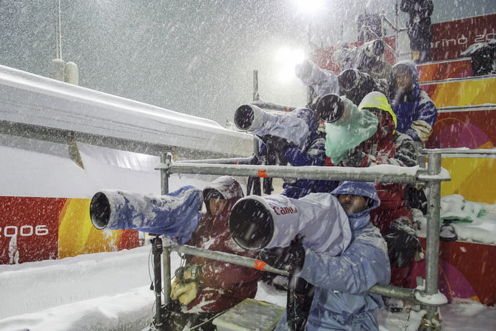 photograph the olympics winter 2018 photographers sit during a heavy snowfal